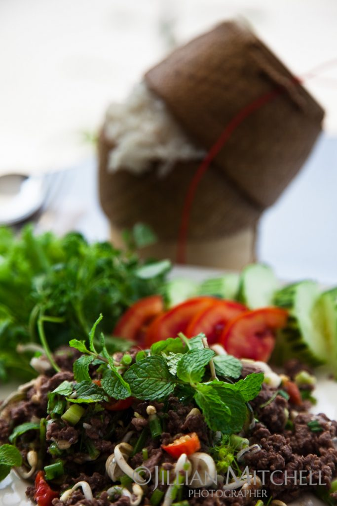 A fresh spicy dish of beef with been sprouts and herbs make a delicious take on this traditional Lao classic.