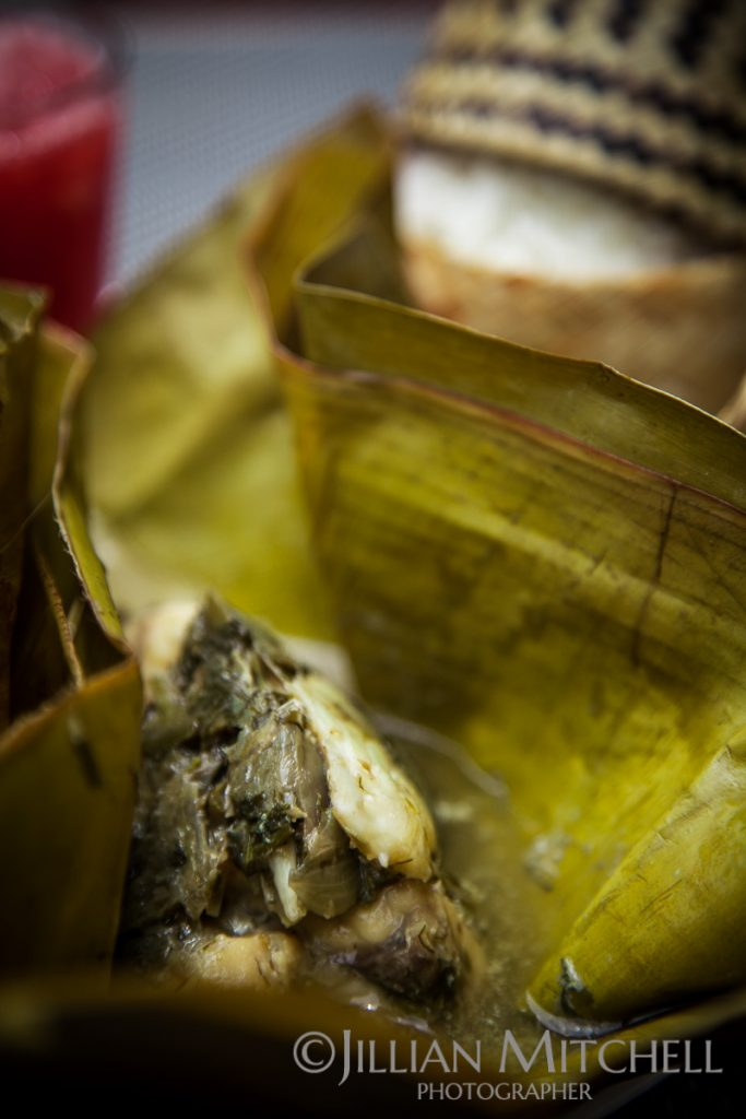 Mok Pa - Fish steamed in a banana leaf with basil and dill with sticky rice.
