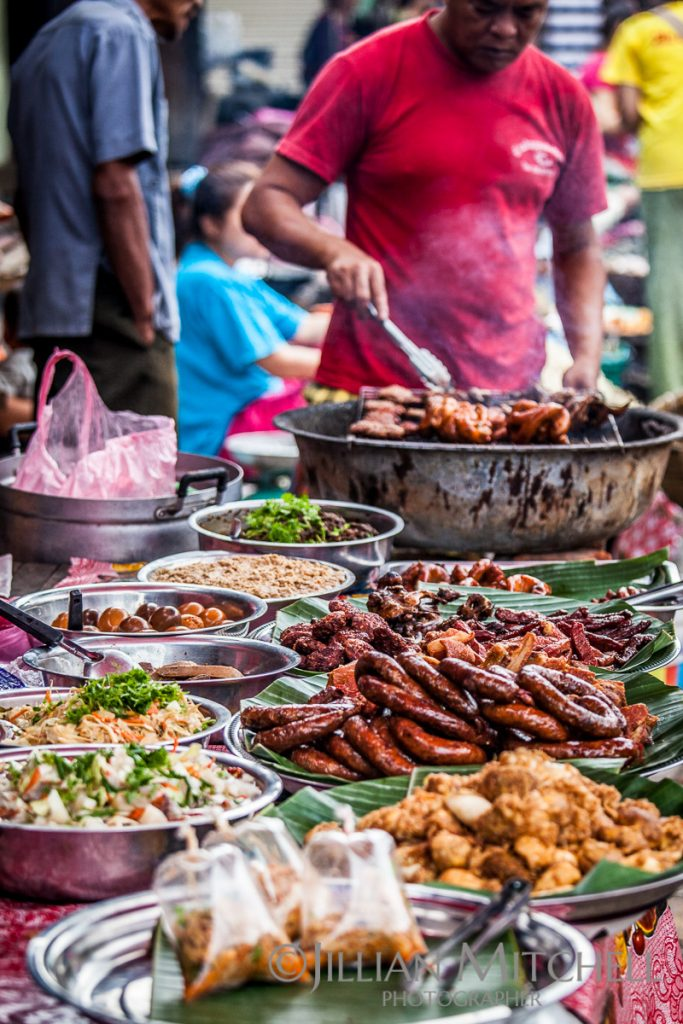 Experiencing the early morning fresh food market in Luang Prabang, Laos.