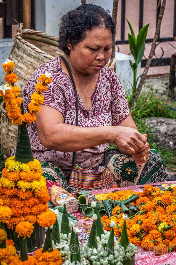 Woman making Mak Beng a traditional spiritual Buddhist offering, Luang Prabang