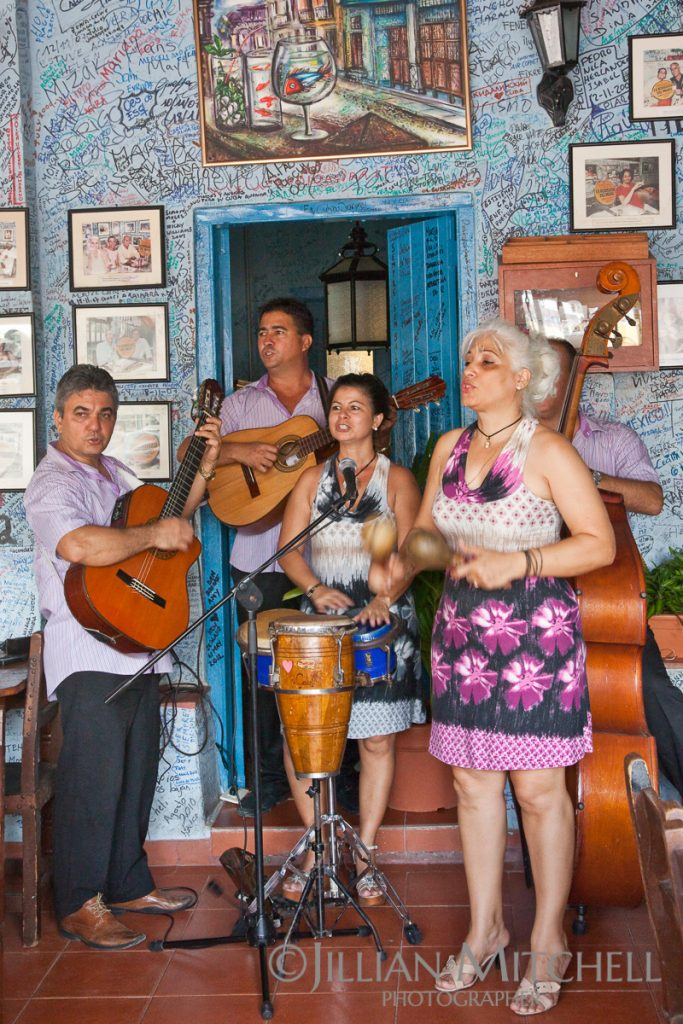 Cuban band plays in La Bodeguita del Medio, apparently once Hemingway's favourite bar in Old Havana and considered the birthplace of the Mojito.